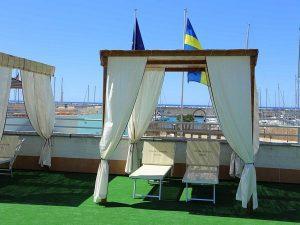 trainingskamp organiseren plannen regelen voetbalteam italie ligurische kust chiavari zonnebed